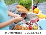 woman drinking wine on picnic   Shutterstock . vector #720337615