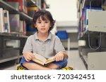 little child boy reading a book ...   Shutterstock . vector #720342451