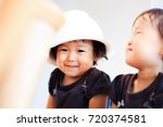 cute child playing indoors   Shutterstock . vector #720374581