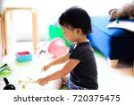 cute child playing indoors   Shutterstock . vector #720375475