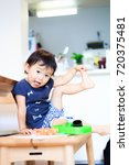 cute child playing indoors   Shutterstock . vector #720375481