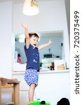 cute child playing indoors   Shutterstock . vector #720375499