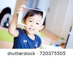 cute child playing indoors   Shutterstock . vector #720375505