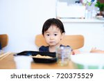 cute child playing indoors   Shutterstock . vector #720375529