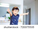 cute child playing indoors   Shutterstock . vector #720375535