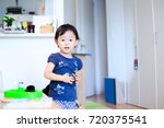 cute child playing indoors   Shutterstock . vector #720375541