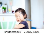 cute child playing indoors   Shutterstock . vector #720376321