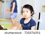 cute child playing indoors   Shutterstock . vector #720376351