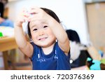 cute child playing indoors   Shutterstock . vector #720376369
