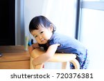 cute child playing indoors   Shutterstock . vector #720376381