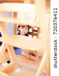 cute child playing indoors   Shutterstock . vector #720376411
