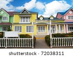 Wooden Houses Painted In...