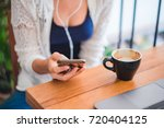 girl listening music and drink...   Shutterstock . vector #720404125