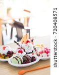 ice cream and toppings in cafe | Shutterstock . vector #720408571