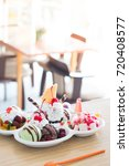 ice cream and toppings in cafe | Shutterstock . vector #720408577