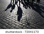 Shadows Of People Walking In A...