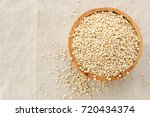 Stock photo quinoa in bowl from top view background with space 720434374
