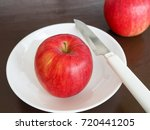 one red apple place on a white... | Shutterstock . vector #720441205