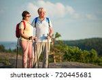 active senior couple hiking on... | Shutterstock . vector #720445681