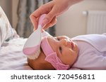 mother comb hair of new born... | Shutterstock . vector #720456811