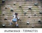 little girl climbing the wall | Shutterstock . vector #720462721