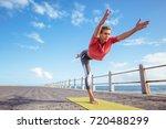 woman doing virabhadrasana yoga ... | Shutterstock . vector #720488299