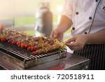 asian men are cooking barbecue...   Shutterstock . vector #720518911