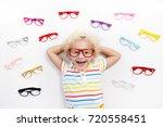 child at eye sight test. little ... | Shutterstock . vector #720558451