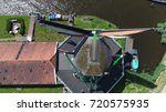 Small photo of Low altitude aerial photo of Zaanse Schans top-down view above a well-preserved historic windmill popular tourist attraction in Holland the Netherlands