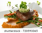 delicious beef steak with green ...   Shutterstock . vector #720593365
