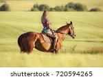 woman ride horse    Shutterstock . vector #720594265