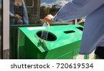 woman throwing plastic bottle... | Shutterstock . vector #720619534
