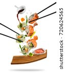 sushi pieces placed between... | Shutterstock . vector #720624565