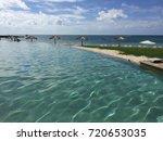 resort infinity pool | Shutterstock . vector #720653035