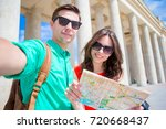 happy tourist couple  man and... | Shutterstock . vector #720668437