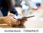 using cellphone | Shutterstock . vector #720669625