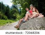 Mountain trek - mother with daughters on trek - stock photo