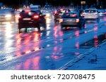 city road during rain. cars... | Shutterstock . vector #720708475