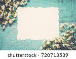 white flowers and paper card on ... | Shutterstock . vector #720713539