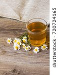 cup of tea with chamomile... | Shutterstock . vector #720724165
