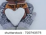 female hands in mittens and... | Shutterstock . vector #720743575