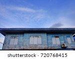 vintage blue house in wooden... | Shutterstock . vector #720768415