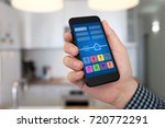 man hand holding phone with app ... | Shutterstock . vector #720772291