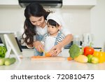 mother with her daughter... | Shutterstock . vector #720810475