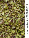 Small photo of A large amount of chopped and whole pistachio nuts.