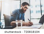 young pensive man working at... | Shutterstock . vector #720818104