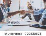 business partnership handshake... | Shutterstock . vector #720820825