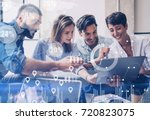 Small photo of Concept of digital diagram,graph interfaces,virtual screen,connections icon on blurred background.Group of colleagues working with startup project in modern office..Horizontal