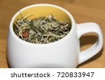 cup with dry green herbal tea... | Shutterstock . vector #720833947