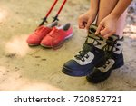 Small photo of Holidays trip camping tourism relax trekking concept. Girl compare footwear. Hiking female examine her boots during break.